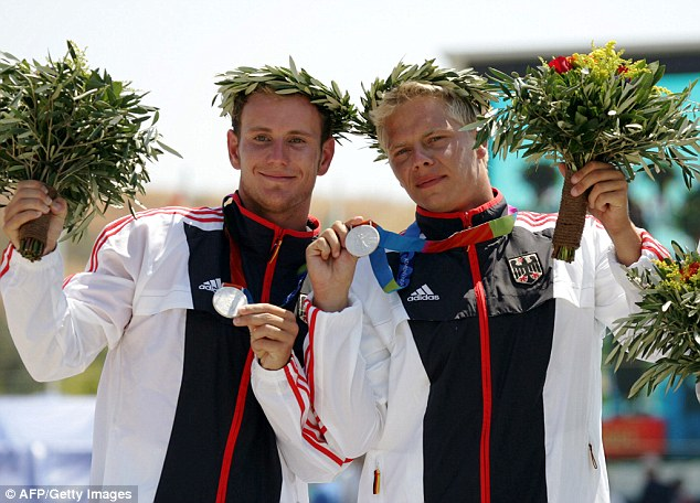 Doctors say that Ivonette's new heart is doing really well and is in perfect condition because Henze was so fit and heathly. Pictured: The tragic star (right) celebrating his 2004 silver medal