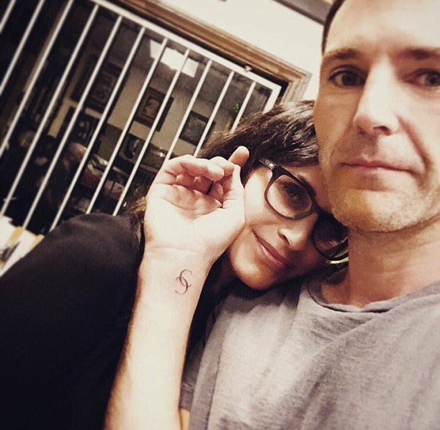 Fresh ink:Johnny McDaid has proved his commitment to Courteney Cox by getting her initials tattooed on his wrist