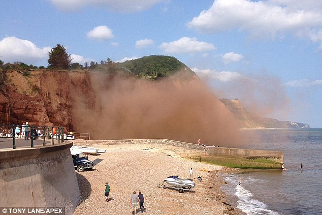 Alert: A local lifeboat coxswain said there have been 'endless cliff falls all summer along that very stretch of cliff'. Pictured is a file picture from August 2014 of a cliff fall at Sidmouth