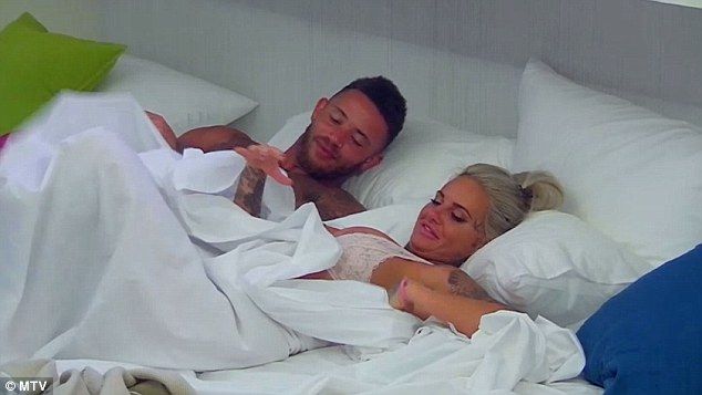 Cat that got the cream: In a new clip the tattooed model, 28, can be seen enjoying a steamy session between the sheets with Ashley Cain only for their romp to be interrupted