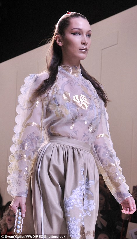 Not quite what it seams: Bella's top, which was semi-sheer, featured a variety of patterns, with raised and embellished seams