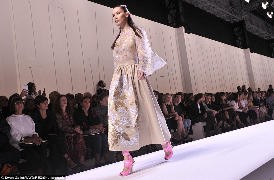 It's a cover-up: Bella took to the runway in a notably more conservative number, which completely covered her svelte frame