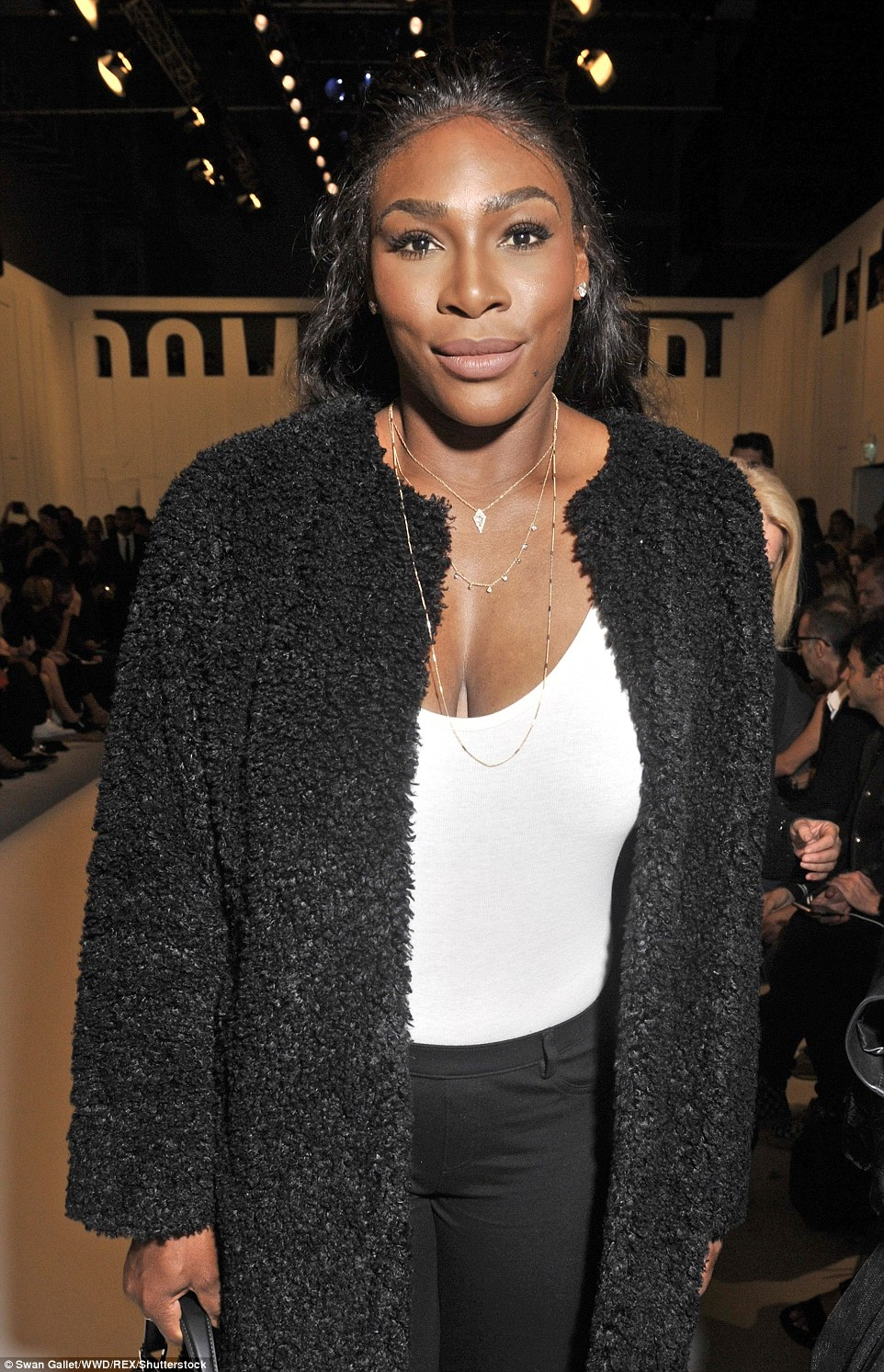 Shine bright like a diamond: A series of necklaces and a pair of diamond earrings gave her chic ensemble a sparkly touch