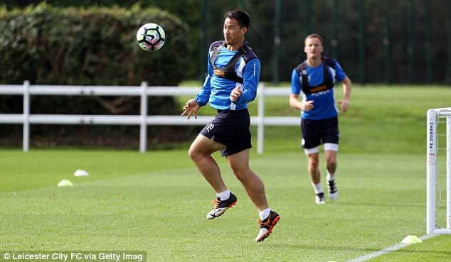 Shinji Okazaki brings the ball down on his chest during the session at Belvoir Drive
