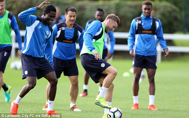 Vardy tries a pirouette as he is watched by team-mates including Okazaki