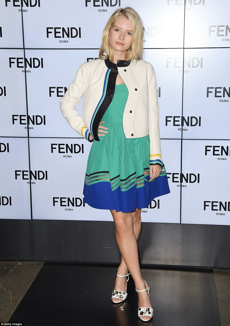 Fashion royalty: Model Lottie Moss, younger sister of supermodel Kate Moss, looked stylish in a green dress with blue hem