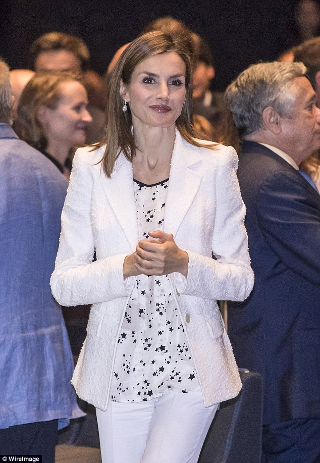 Queen Letizia of Spain opts for black and white as she attends an event for theSpanish Association Against Cancer before giving an impassioned speech on the disease