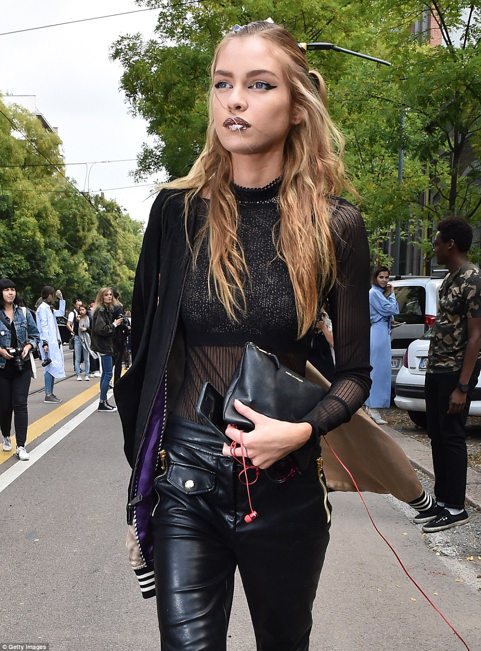 Change clothes: With her hair and makeup intact from the show, she threw on a semi-sheer top and leather trousers