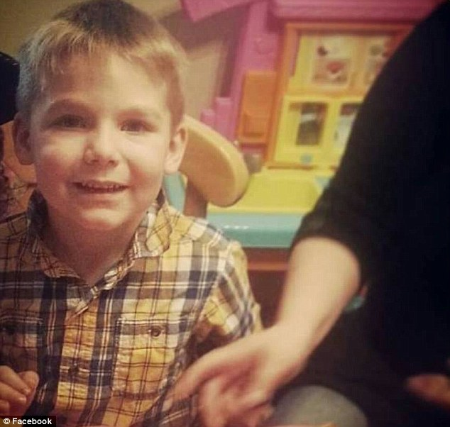 During soccer practice, Aidan Heath, seven, was running drills when he suddenly fell over
