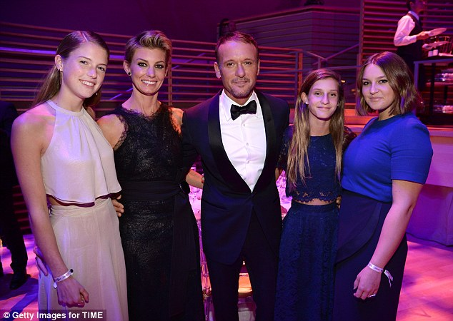 Happy family: The highly-popular country couple have three daughters together: Gracie Katherine (far right), 19, Maggie Elizabeth (far left), 18, and 14-year-old Audrey Caroline (second from right)