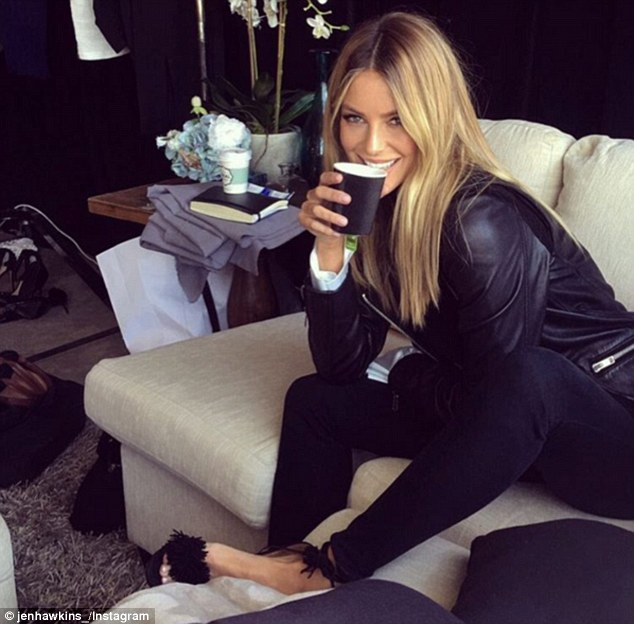 Chic: Jennifer Hawkins took time out to put her feet up, literally, in between walking the runway at the Telstra Perth Fashion Festival on Thursday