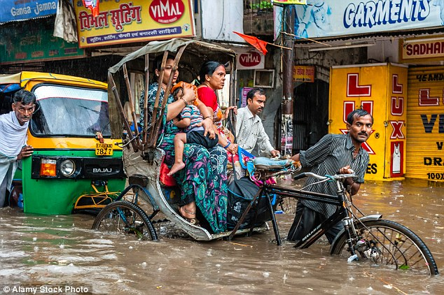 Severe flooding in India (pictured) around 2006 coincided with a subsequent fall in British tourism