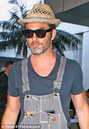 Ditching dapper? The 36-year-old Star Trek star eschewed usual clean-cut image and preppy wardrobe for a pair of dungarees teamed with a straw hat and a peppered beard