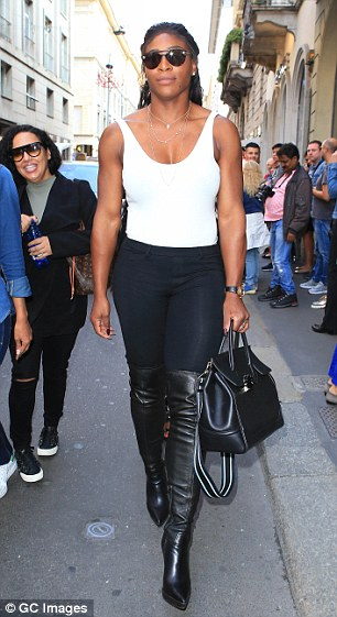 On the move:Serena wore a plunging white top tucked into a pair of black skinny jeans