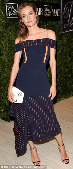 Breathtaking:The actress and model stunned in a navy blue dress that was off the shoulders with a floaty skirt