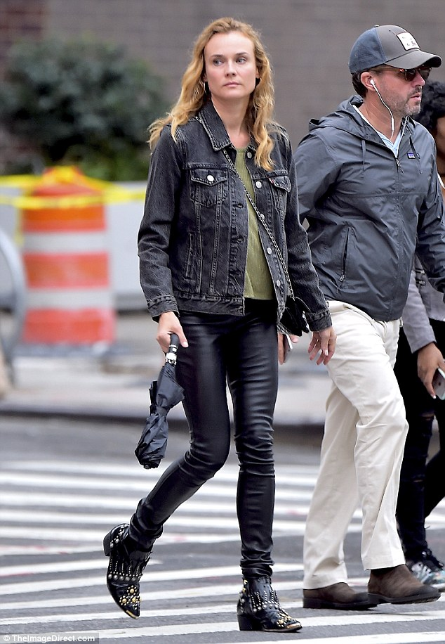 Casual cool:She kept up the theme of her look with a pair of black leather biker boots with studs all over it as she also wore a green T-shirt