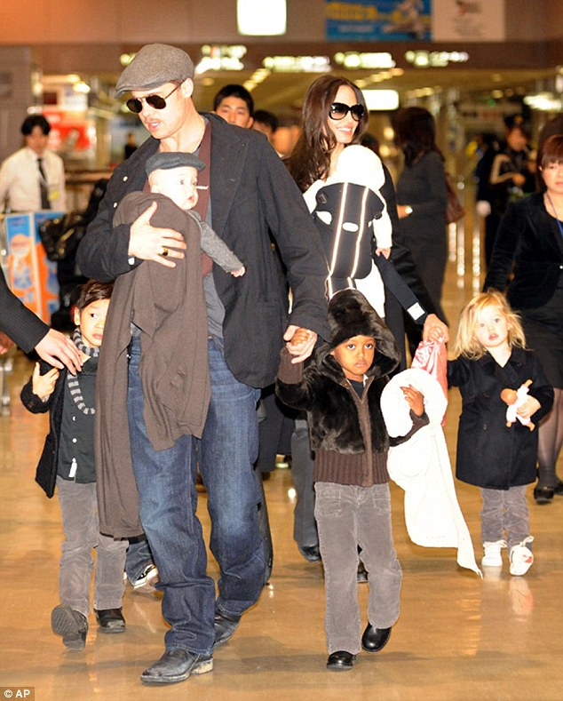 The brood: Together Brad and Angelina have six children; here they are seen with the kids in Tokyo in 2009