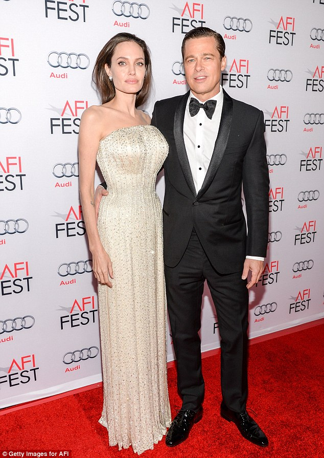 Difficult:Jolie has suffered the worst crisis of her life as her estranged husband Brad Pitt is allegedly being investigated by the FBI for child abuse after a September 14 incident; here they are seen during their last red carpet appearance together in November