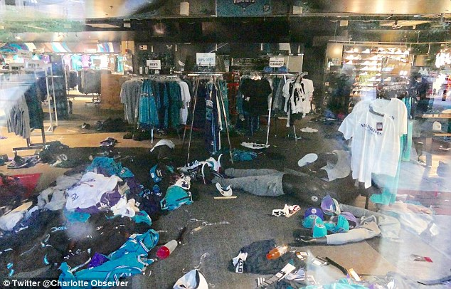 Appeal for calm: Michael Jordan, owner of the Charlotte Hornets, whose store was trashed on Wednesday night, called on the community to come together