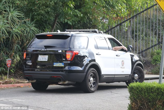 Ugly situation: Los Angeles police were seen arriving to Brad's home in Hollywood on Thursday