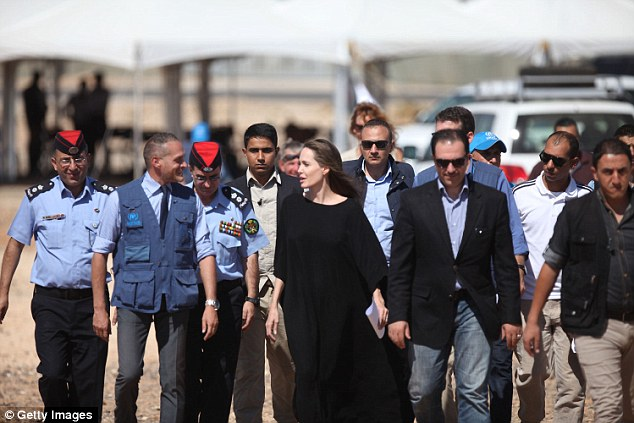 She had heavy security: Here the LA native, whose father is Jon Voight, was surrounded by Jordanian military