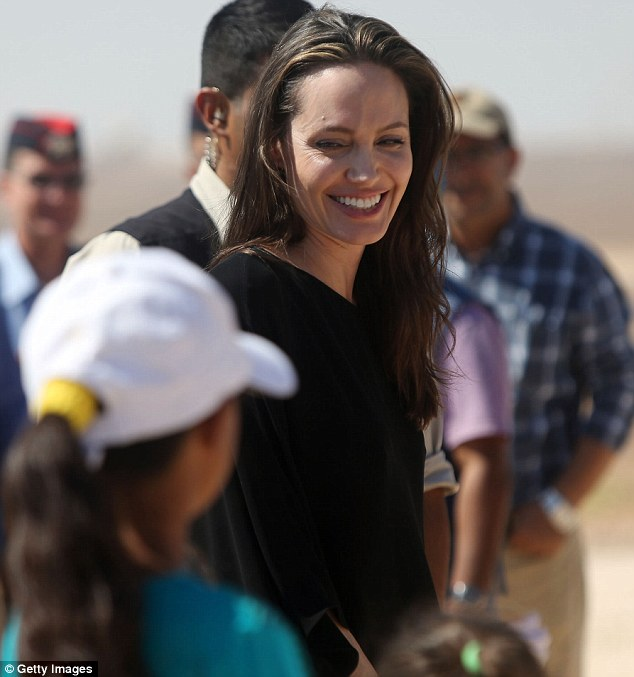 In good spirits: Angelina Jolie was seen smiling while in North Jordan just five days before her ugly fight with Brad Pitt aboard a private jet which led to her filing for divorce on Monday