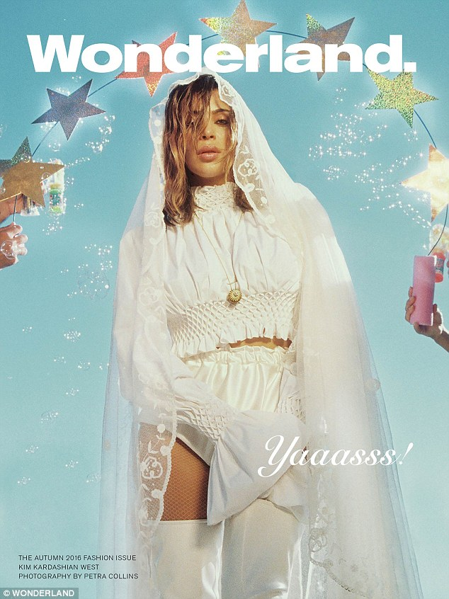 Best pout: For the Wonderland cover, the reality star, 35, looks like a wacky bride in long white veil with white satin two-piece, white fishnet stockings and thigh-high white boots