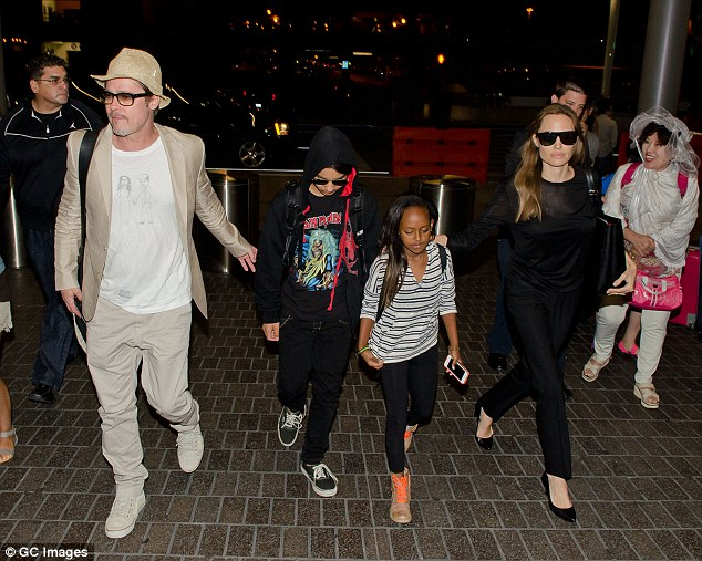 Family: The move came after he was allegedly abusive to their children on a flight home from France last Wednesday (Couple above with Maddox and Zahara in 2014)