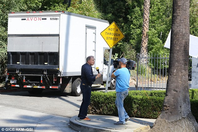 Moving out: Moving vans have been seen coming and going from the couple's Los Feliz property over the past few days (above)