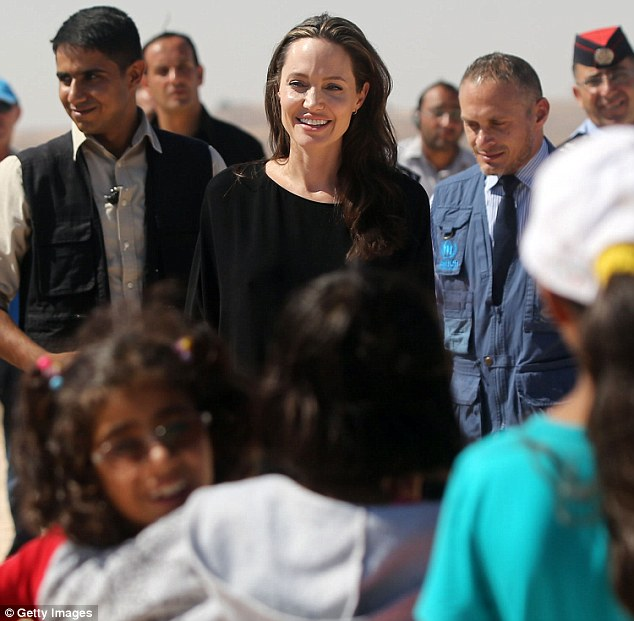 No sign of stress: The Oscar winner appeared at ease as she was surrounded by UN officials