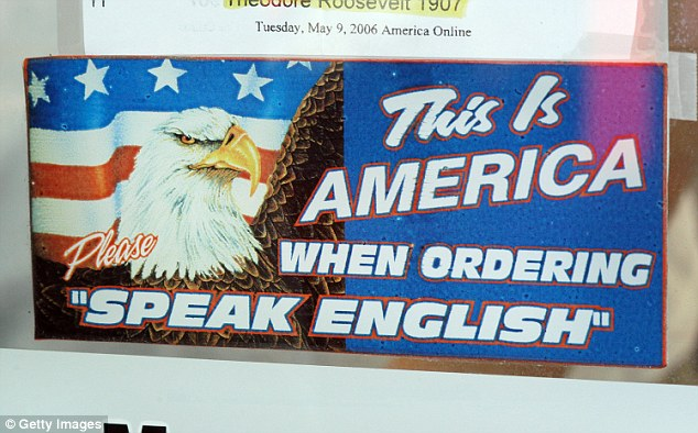 """MAS QUESO POR FAVOR:A sign at at the legendary business states: 'This Is America: When Ordering Please """"Speak English""""'"""