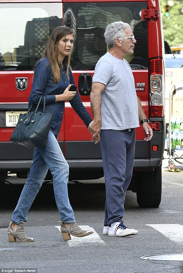 The unidentified brunette looked relaxed, as she wore a denim shirt paired with denim jeans and chic booties, while accompanying Epstein (above)