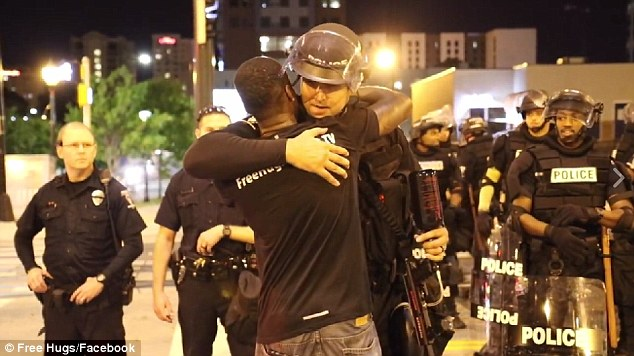 Ken Nwadike, of the Free Hugs Project, headed to Charlotte to offer embraces to all amid riots in the city over the fatal police shooting of a black man
