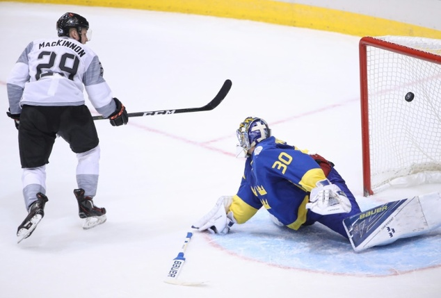 Nathan MacKinnon of Team North America scores the game-winning goal in overtime past Team Sweden goalkeeper Henrik Lundqvist during their World Cup of Hockey...