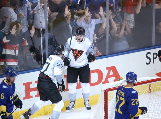 Auston Matthews (C) of Team North America celebrates his first period power play goal during their World Cup of Hockey game against Team Sweden, at the Air C...
