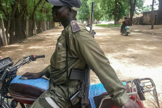 A Cameroonian policeman patrols in Kourgui, in the extreme northern province, west of the Nigerian border, on September 16, 2016