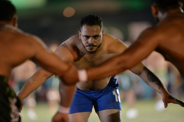 An Indian kabaddi player (C) attempts to tag a Pakistani opponent during the 3rd Asian Kabaddi Circle Style Championship in Wah, Pakistan, in May 2016