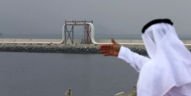 An Emirati man stands in front of a pipeline at the oil terminal of Fujairah during the inauguration ceremony of a dock for supertankers on September 21, 2016