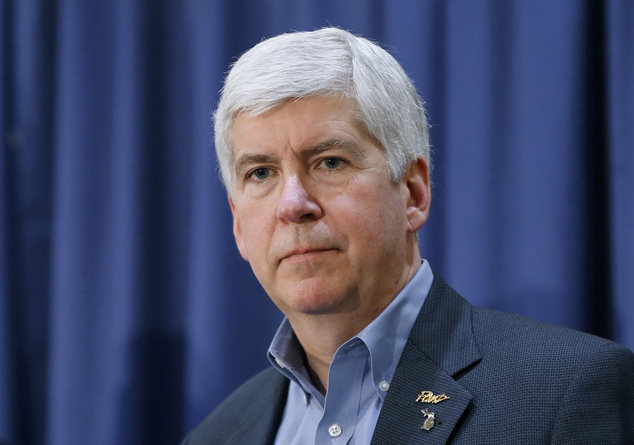 FILE - In this Feb. 26, 2016, file photo, Michigan Gov. Rick Snyder listens to a question after attending a Flint Water Interagency Coordinating Committee me...
