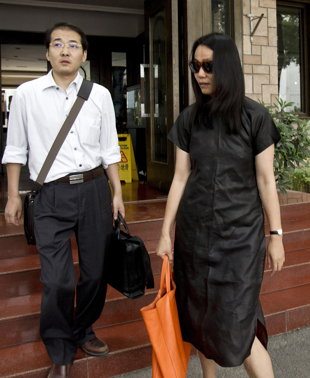 FILE - In this July 14, 2011, file photo, lawyer Xia Lin, left, walks with Lu Qing, wife of outspoken Chinese artist Ai Weiwei, as they head to the Beijing L...