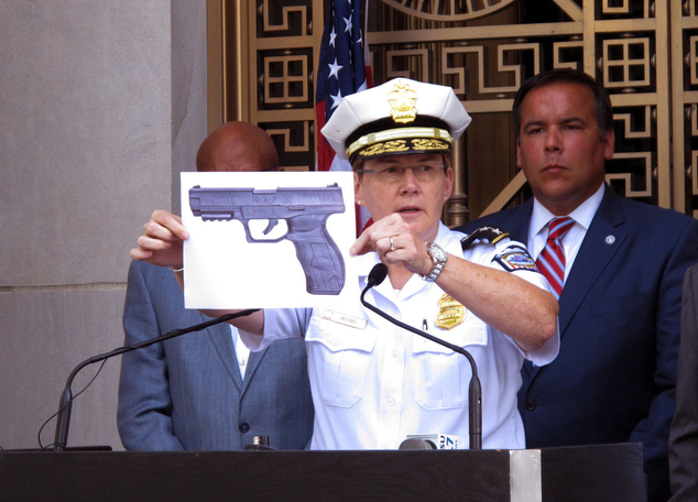 FILE - In this Thursday, Sept. 15, 2016, file photo, Columbus, Ohio, Police Chief Kim Jacobs displays a photo of the type of BB gun police say Tyre King pull...