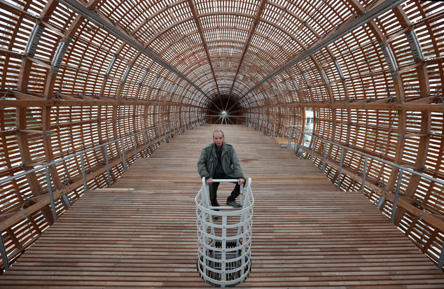 Leos Valka, a co-creator, poses for a photo inside a giant object resembling a zeppelin airship at an arts center in Prague, Czech Republic, Monday, Sept. 19...