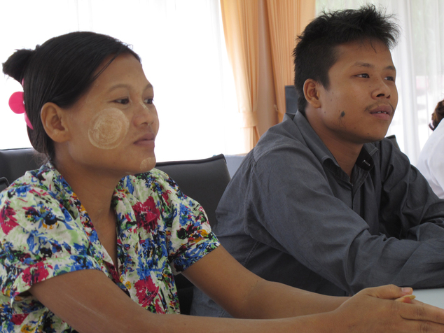 FILE - In this June 24, 2016, file photo, Burmese former shrimp shed worker Tin Nyo Win, right, sits next to his pregnant wife Mi San during an interview in ...