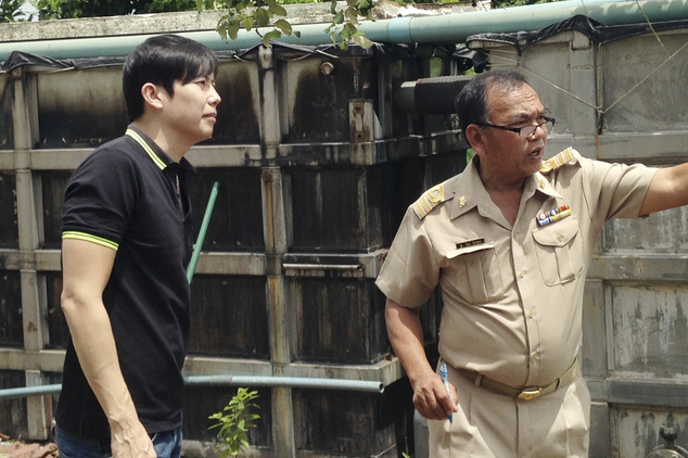 In this Aug. 15, 2016, photo, Capt. Thaned Juntaklin, right, from the Department of Industrial Works, and Boonchai Seafood director Taweesak Suralertrungson ...
