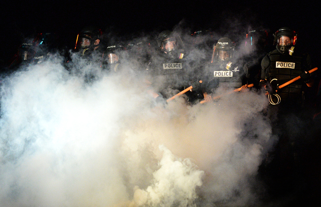 Police stand in formation in Charlotte, N.C., Tuesday, Sept. 20, 2016. Authorities used tear gas to disperse protesters in an overnight demonstration that br...