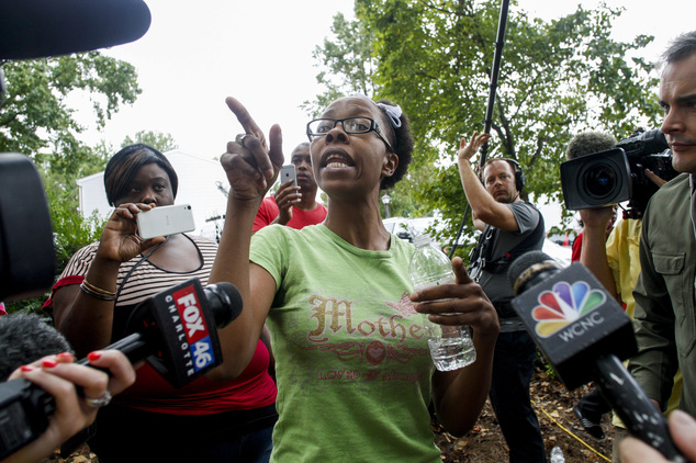 Taheshia Williams, center, tells her eyewitness account of the police shooting of Keith Lamont Scott, in Charlotte, N.C. Wednesday, Sept. 21, 2016. Scott's d...