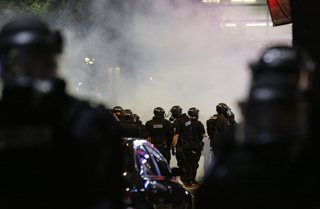 Police fire teargas as protestors converge on downtown following Tuesday's police shooting of Keith Lamont Scott in Charlotte, N.C., Wednesday, Sept. 21, 201...