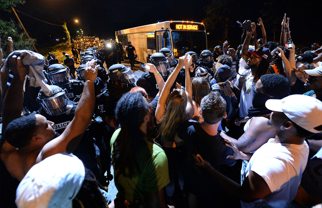 Protesters clash with police in Charlotte, N.C. on Tuesday, Sept. 20, 2016. Authorities used tear gas to disperse protesters in an overnight demonstration th...
