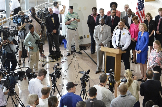 From left, at podium; Willie Ratchford, Charlotte-Mecklenburg Community Relations, Charlotte-Mecklenburg Police Department Chief Kerr Putney and Charlotte Ma...