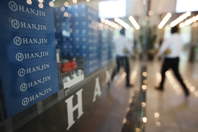 A model of container ship with Hanjin Shipping Co.'s logos is displayed at its head office in Seoul, South Korea, Thursday, Sept. 22, 2016. Hanjin Shipping i...